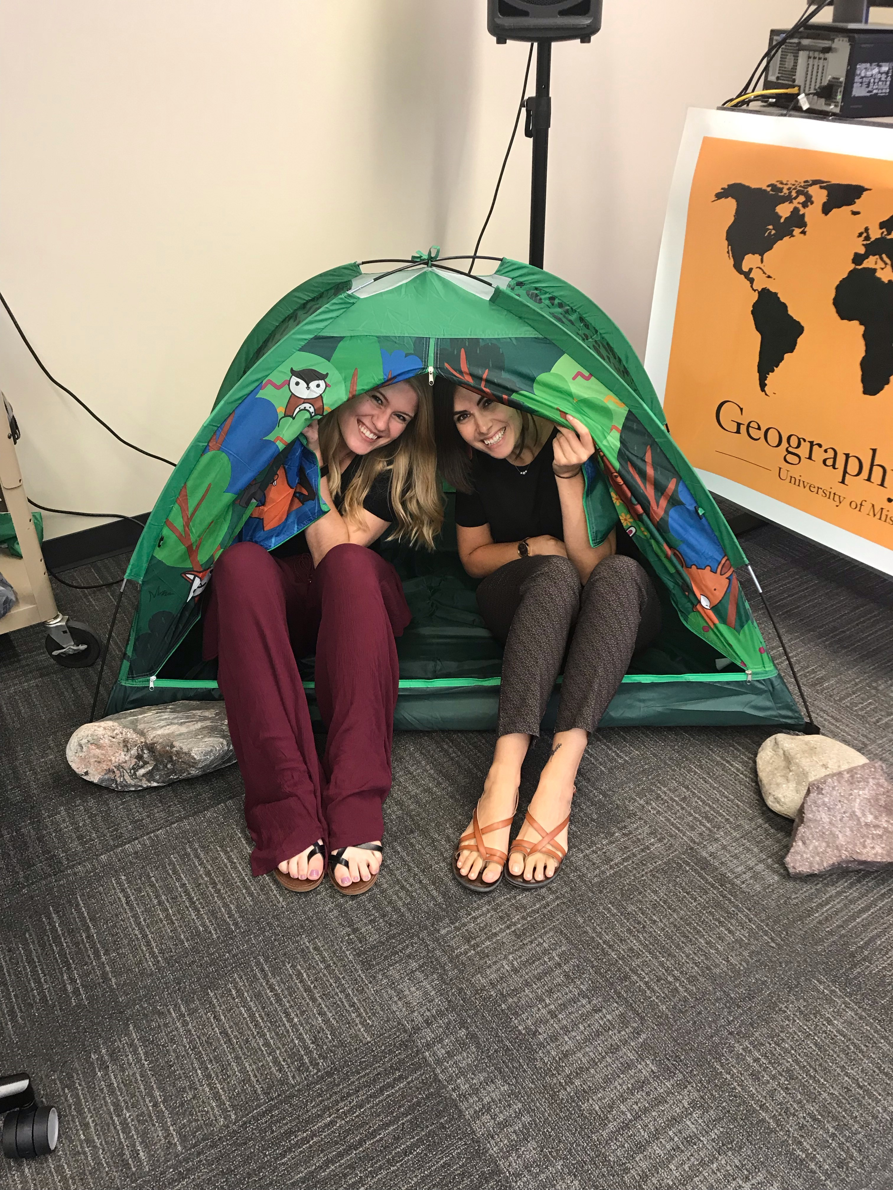 Meymester Tent. Pictured are Sydney Bailey and Taylor Fox, both grad students in the Department of Geography..