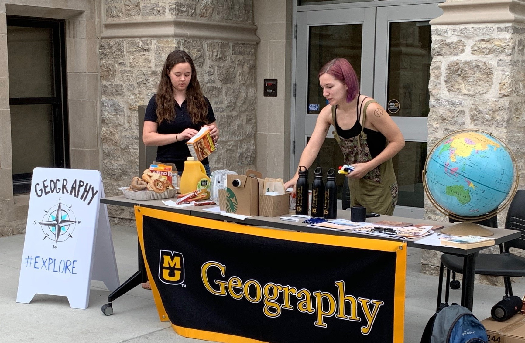 Students arrived early Friday morning to set up the geography booth for the 10 a.m. to 12 p.m. event.