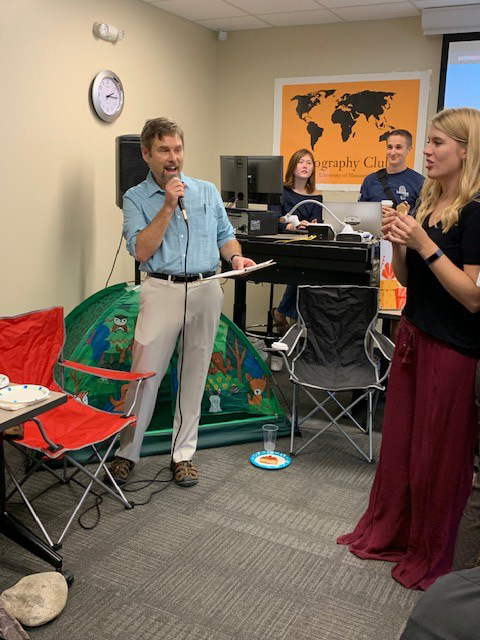 Geography department chair Soren Larsen giving out door prizes at the #Explore Geography Open House.