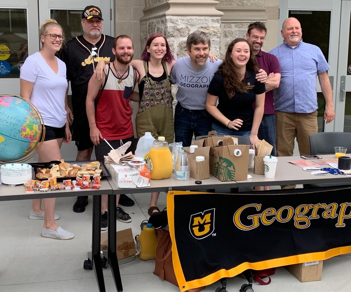 Geography students and faculty work the Summer Welcome